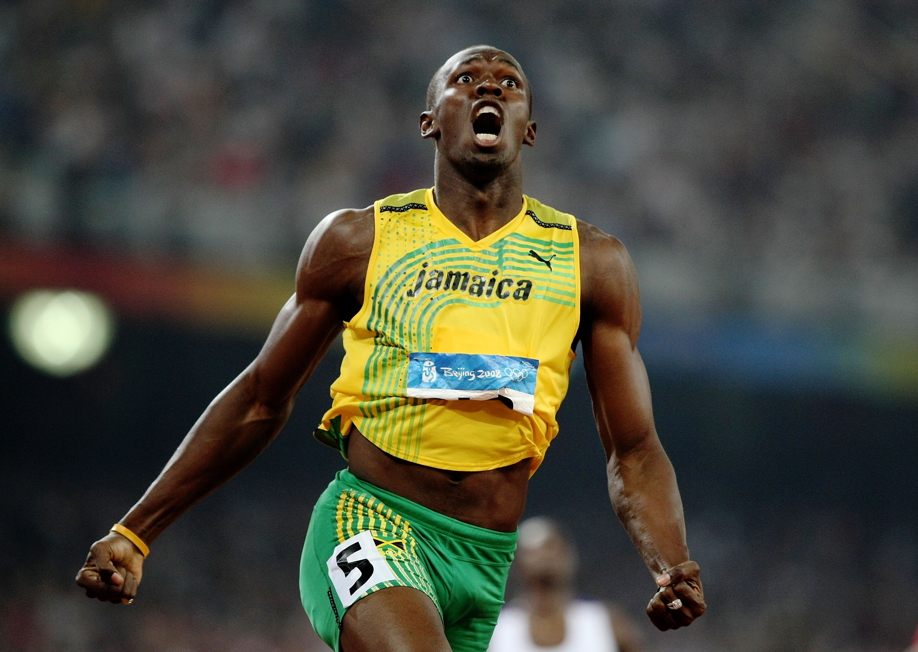 BEIJING - AUGUST 20:  Usain Bolt of Jamaica reacts after breaking the world record with a time of 19.30 to win the gold medal in the Men's 200m Final at the National Stadium during Day 12 of the Beijing 2008 Olympic Games on August 20, 2008 in Beijing, China.  (Photo by Jed Jacobsohn/Getty Images)