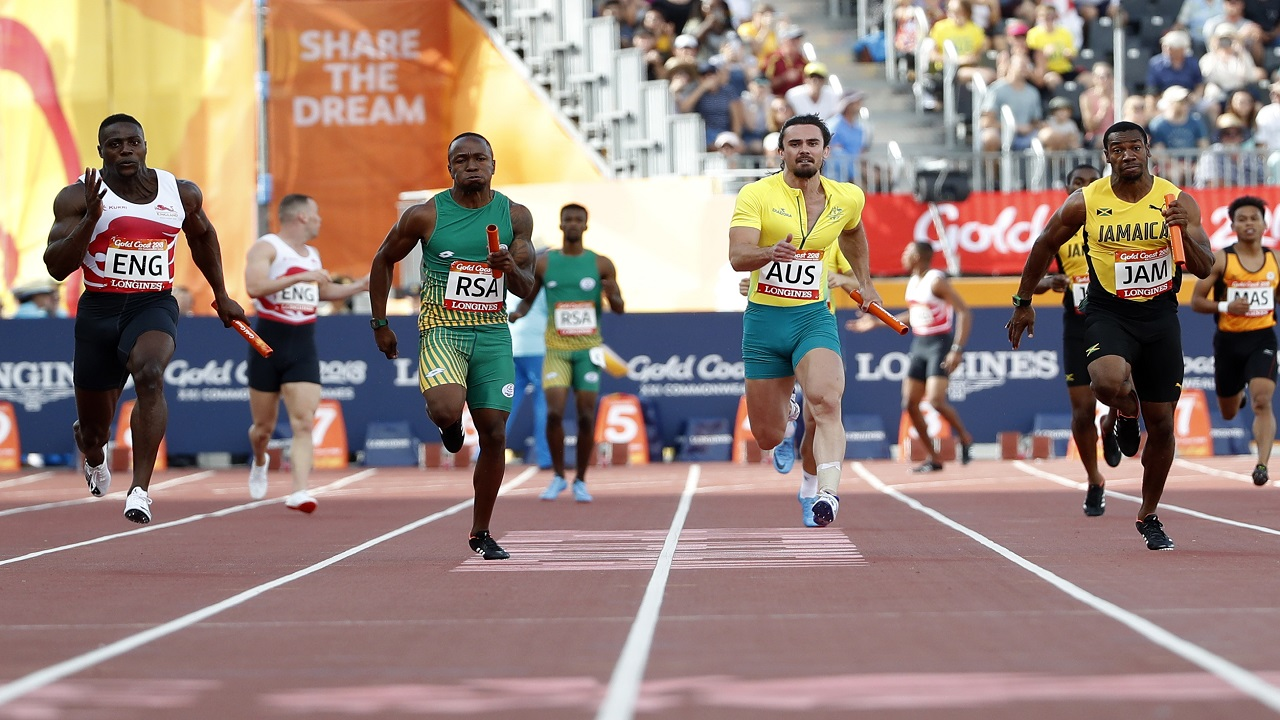 England's Harry Aikines-Aryeetey, left, leads South Africa's Akani Simbine, second left, Australia's Josh Clarke and Jamaica's Yohan Blake, right, to win the men's 4x100 relay at Carrara Stadium during the 2018 Commonwealth Games on the Gold Coast, Australia, Saturday, April 14, 2018. (AP Photo/Mark Schiefelbein)